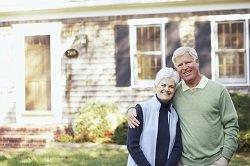 senior-couple-in-front-of-home-housing-options-for-elderly_resized