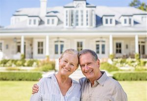 6113-07146938 © Masterfile Royalty-Free Model Release: Yes Property Release: Yes Portrait of smiling senior couple in front of house